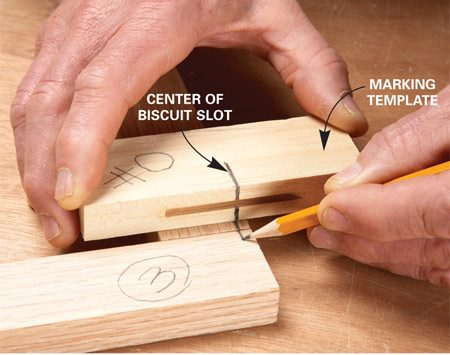 <b>Photo 1: Use a template to align the slot</b></br> Cut a biscuit slot in a scrap of wood and mark the center and the size of the slot, in this case No. 0. Now use the template to position the biscuit mark. We offset this slot to the top where the protruding biscuit can be cut off and the slot won't show.