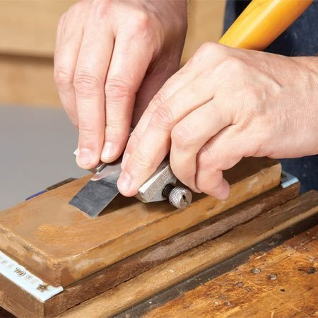 <b>Honing guide in action</b></br> This little gem firmly holds chisels up to 1-1/2 in. wide and plane irons up to 2-3/4 in. wide. The guide is adjustable, so you can choose virtually any bevel angle, and it's precise enough to set micro bevels.