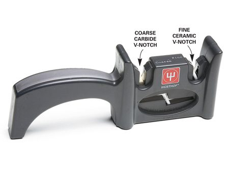 """<b>Photo 2: A V-sharpener</b></br> <p>A V-sharpener has two pairs of cutting edges in a V-configuration (Photo 2). One side is made from carbide for roughing out an edge and the other has ceramic material for fine-tuning the edge. The """"V"""" grinds both sides of the knife at once.</p>"""
