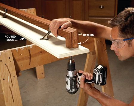 <b>Photo 1: Attach the returns with screws</b><br/>Position the handrail on the board so the space above the rail and below the brackets is about the same, spacing the rail evenly from both ends. Drill pilot and countersink holes and screw through the board into the returns with 2-in. screws.