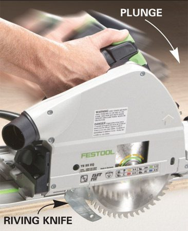 <b>Photo 1: You push, the blade plunges</b></br> Unlike your circular saw, this has no clumsy blade guard to fight. On the DeWalt and Festool, a riving knife follows the blade, reducing kickback and blade-pinching.
