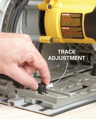 <b>Photo 2: Precision guidance system</b></br> Unlike a straightedge, the rail won't let the saw veer off course. Adjustment knobs fine-tune the fit between the saw's shoe and the track, so there's zero slop.