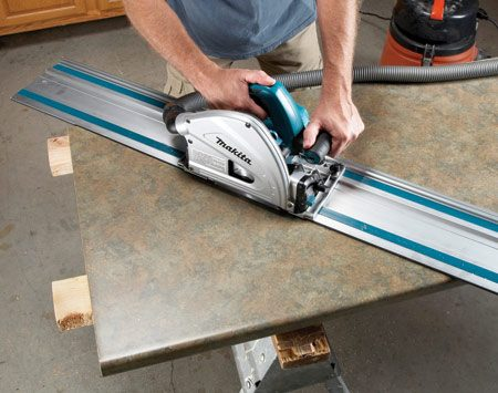 <b>Cut long miters</b></br> Mark your miter first, then align the guide and make the cut.