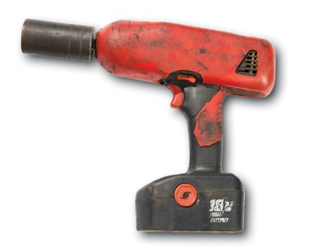 <b>Close-up of battery-powered impact wrench</b></br> Blast off any nut or bolt with a heavy-duty, battery-powered impact wrench like this 1/2-in.- drive Snap-on wrench.