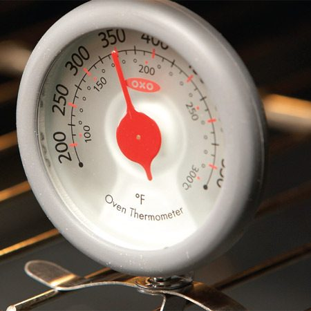 "<b>Photo 2: Adjust the temperature setting</b></br> <p>On this GE oven,  you press the ""bake"" and ""broil"" buttons simultaneously,   and then press  ""bake"" to enter the temperature-adjusting   mode. Then you  keep pressing the ""+"" or ""- "" button to coordinate   the thermostat  with the actual oven temperature. </p>"