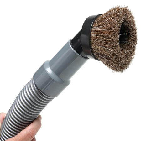 Use a soft brush to vacuum dust before applying varnish or stain.