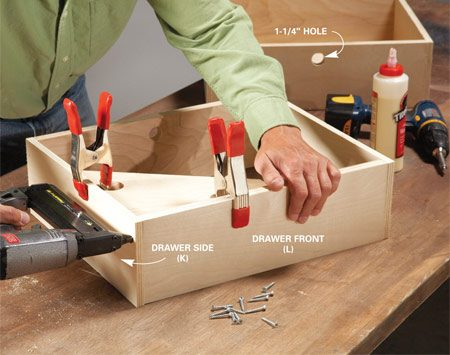 <b>Photo 4: Build the drawers</b></br> Tack them together with nails and glue, then add screws. A squaring jig makes square assembly easy. Drill holes through the back of each drawer to act as a handle.