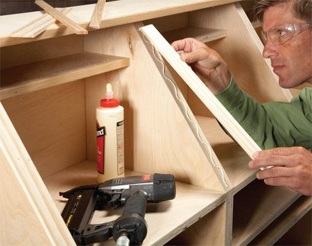 <b>Photo 7: Cover exposed plywood edges</b></br> If the trim is a bit too wide, you can shave it slightly with your table saw. Glue and nail the edging into place.