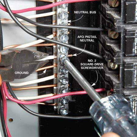 <b>Ground and pigtail go to the neutral bus</b></br> Route the AFCI neutral pigtail and ground wires to empty screws on the neutral bus and tighten. If you're installing a breaker on a subpanel, place the neutral and ground on separate bus bars.