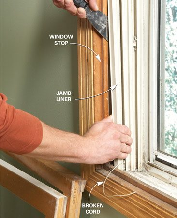 <b>Photo 2: Pry out the jamb liner</b></br> Starting at the bottom, wedge a stiff putty knife into the crack between the jamb liner and the window stop. Pry the jamb liner flange out from under the stop. Then slide the putty knife upward to release the jamb liner.