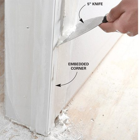 <b>First pass</b></br> After positioning the bead, wipe and smooth off excess joint compound with a 5- or 6-in. putty knife. Press the edge of the tape with the knife blade to ensure a tight bond with the drywall.