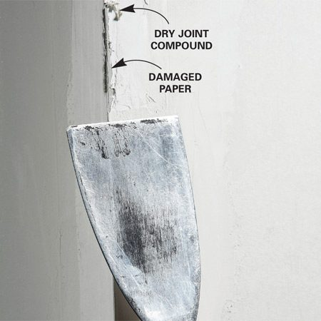 <b>Don't gouge dry corners</b></br> Scraping dried joint compound from the corner can damage the paper tape. Remove excess joint compound before it hardens. Carefully slide a putty knife along the outside edge to knock off excess joint compound.