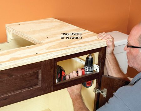 <b>Photo 2: Build the plywood base</b><br/>Two layers of plywood make a stiff, strong base for the tile. Mark and cut the plywood carefully to make sure the top is perfectly square.