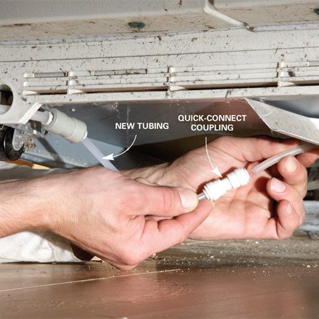 <b>Photo 3: Splice in a new section of tubing</b></br> Quick-connect couplings simplify this repair. Just push cut ends of the tubing into the coupling for a leak-free connection.