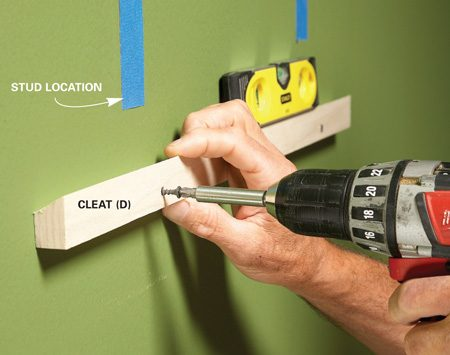 <b>Photo 5: Mount the cleat</b></br> Level the cleat and screw it to the wall. You can locate studs or use drywall anchors.