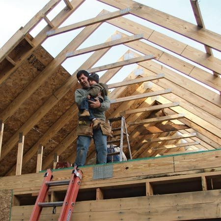 <b>Attic trusses</b></br> Ben Westby used attic trusses to get a second-floor room on his garage. Ben and his nephew helper, Garret, are enjoying the view from the big, wide open space.