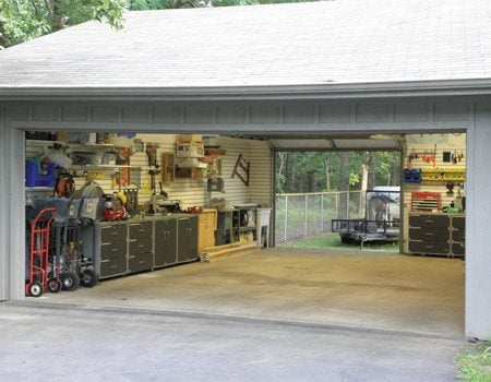 <b>Drive through garage</b></br> Kristin Green wanted to park the boat and trailer out of sight behind the garage, and a back door made it possible.