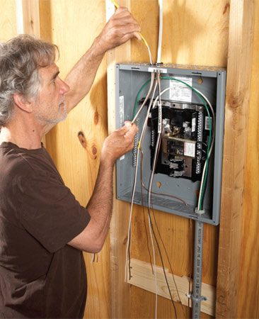 <b>Garage subpanel</b></br> A subpanel is just like your main circuit breaker panel but with special wiring. The neutral bar must be isolated from the ground and the main breaker secured with a special tie down mechanism. This box has room for 12 circuit breakers.