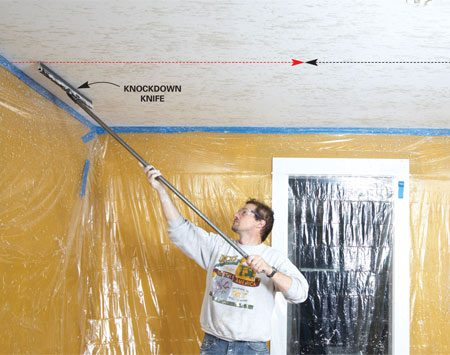 <b>Knock down the texture</b></br> Drag the knockdown knife in straight, overlapping courses. Work inward from both edges  of the ceiling, and keep moving. The splatters dry and harden quickly.