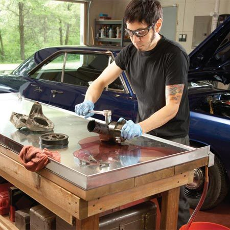 <b>Add a metal cover to your existing workbench</b></br> Drop auto and small components on the metal workbench cover and blast off the bolts. The drip edge catches the oil spills and the metal cover prevents grease stains.