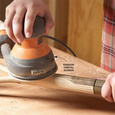 <b>Photo 1: Sand the handles smooth</b></br> A random orbital sander makes short work of the sanding job. Keep it moving so you don't create a flat spot.
