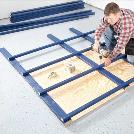 <b>Photo 2: Assemble the frames</b></br> Working on top of a sheet of plywood helps keep each frame  squared up. Use the edges of the plywood to line up and adjust  things as you screw the frame together. It also really helps to pick  the straightest lumber possible when you're shopping.