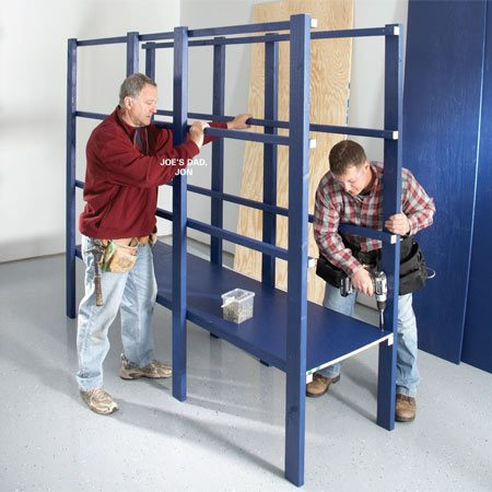 <b>Photo 3: Screw on the shelves </b></br> Installing the shelves in each frame is a lot easier if you have a  helper to hold the frames. If you're working alone, lean one of the  frames against the wall and hold up the other frame while you  screw the first shelf into place.