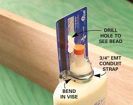<b>Use credit card and EMT conduit strap</b></br> <p>To make spreading glue less messy, all you need is an old credit card, a 3/4-in. two-hole EMT conduit strap and two 1/8-in. nuts and bolts. Crook the conduit strap in a vise to level the conduit strap wings with the bottle cap. This way the credit card stays flat when you bolt it on. Drill a couple of window holes in the middle of the credit card so you can monitor the size of the glue bead, then drill bolt holes in the end of the card, snap the conduit strap onto the bottle cap and bolt on the card.</p> <p>Practice applying glue on a scrap board and in a few minutes you'll get it down. Be sure to use fresh glue—the lightly bending card will spread it like butter.</p>