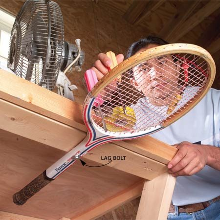 <b>Screw wooden tennis racquet to workbench</b></br> Here's a slick use for that old wooden tennis racquet that's gathering dust in the garage. Drill a hole in the handle and screw it to the underside of a workbench. Position the racquet so it can swing in and out from under the table. Use it to hold tools, parts or other small items.