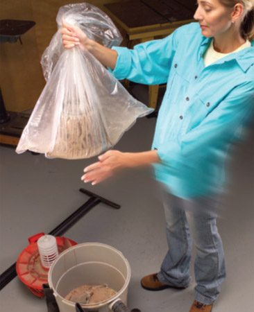 <b>Stick filter in a plastic bag and shake gently</b></br> Here's how to clean your shop vacuum filter without filling the backyard (and your lungs) with a month's worth of shop dust. Stick it in a plastic garbage bag, knot or grip the bag's open end, then gently hit the filter to dislodge the dust. Set the bag down, wait for the dust to settle, then remove the filter and dispose of the bag.