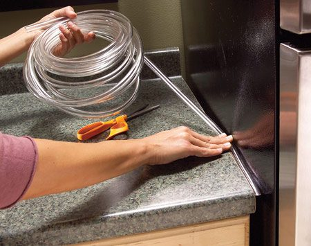 <b>Keep crumbs out with plastic tubing</b></br> If crumbs, papers or even flatware falls into the gap between your countertop and refrigerator, fill the void with nearly invisible plastic tubing. Clear tubing is available at home centers in several widths starting at 1/8 in.