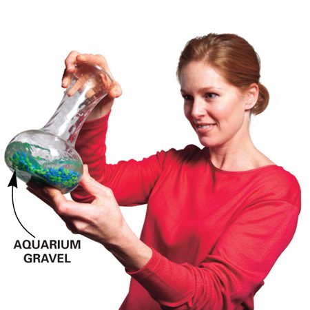 <b>Clean hard-to-reach spots with small gravel</b></br> Clean those narrow-necked jars and vases with small gravel (aquarium gravel works the best). Fill one-third of the jar with water. Add a handful of gravel, and then stir and shake the jar. The gravel will scour the inside of the jar clean. Dump the gravel into a strainer, give it a quick rinse (so it doesn't stink!) and save it for next time.