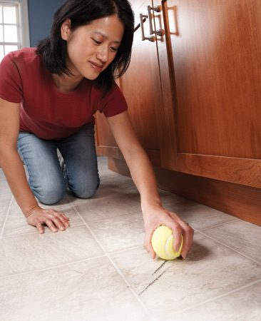 "<b>Rub scuffs marks with a dry tennis ball</b></br> Clean off shoe scuff marks from vinyl flooring with a clean, dry tennis ball. A light rub and heel marks are ""erased""."