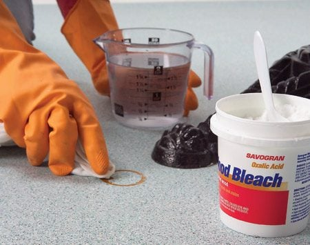 "<b>Use oxalic acid (wood bleach) on rust stains</b></br> <strong>Oxalic acid</strong> is the solution for stubborn rust stains. It's often labeled ""wood bleach""—but not all wood bleach contains oxalic acid, so check the label. Most paint stores and some hardware stores carry oxalic acid. If the stain won't rub off, wet a rag with the acid solution and lay it over the stain for 10 minutes. If the stain remains, rewet the rag and repeat. When that's done, rinse the floor with clean water."