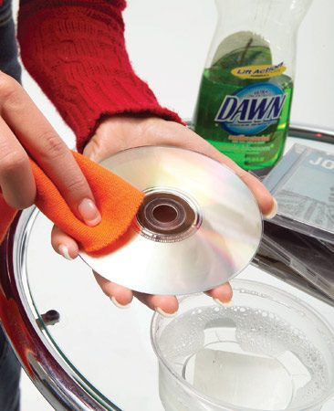 <b>Wipe with water and mild detergent</b></br> If a CD or DVD skips or won't play in a machine that plays other discs flawlessly, cleaning the disc may solve the problem. Disc cleaning kits are available, but all you really need is lukewarm water, a few drops of dish detergent, and a soft, lint-free rag. If the disc still misbehaves after the cleaning, examine it for scratches. Electronics stores carry repair kits to remove minor scratches from CDs and DVDs.