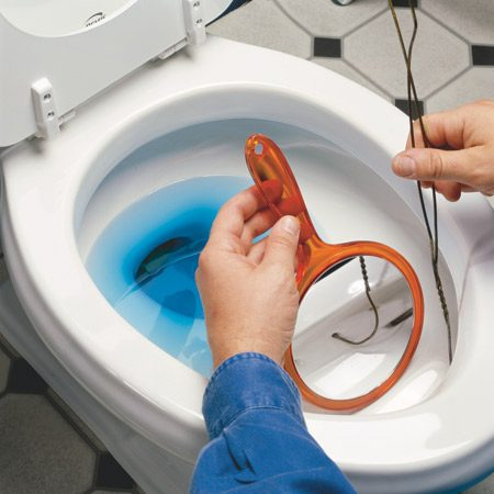 <b>Clean out mineral deposits with a mirror and hanger</b></br> If your toilet flushes slowly, the rinse holes under the rim may be clogged with mineral deposits. Use a hand mirror to see the holes under the rim of the toilet. Bend a coat hanger flat and probe the tip into the holes to poke out any deposits. You can clean out those clogged holes without ever getting your hands dirty.