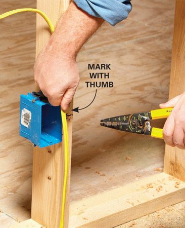 <b>Mark the spot with your thumb</b><br/><p>It&rsquo;s  tempting to push your roughed-in   cable  through the knockouts in the   box and  worry about how to strip the   sheathing  later. But that&rsquo;s the hard   way. It&rsquo;s  much easier to remove the   sheathing  before you push the wires   into the  box. The only trick is to make   sure you  have the cable in about the   right spot  before marking it   and removing the sheathing. </p>