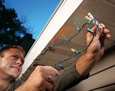 <b>Attach wires with clothes pins</b></br> Instead of poking nails into aluminum soffits and fascia when you're hanging holiday lights, clip the wires to the bottom lips of the fascia with clothespins.