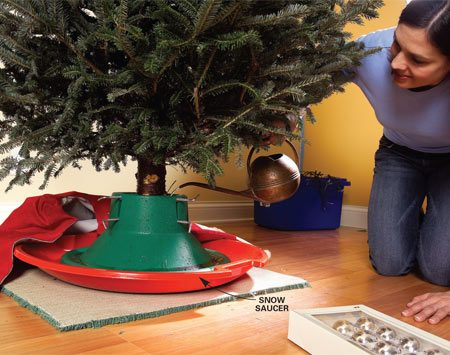 <b>Keep water corralled with a snow saucer</b></br> A plastic snow saucer, the kind with the flat area in the center ($6 at discount stores), is great for keeping overflowing Christmas tree water from staining your floor. Place a carpet remnant under the saucer to prevent scratches on wood flooring.