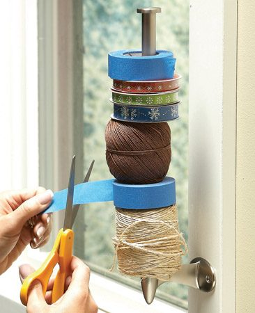 <b>Keep tape and ribbon handy</b></br> Do you keep all your tape, twine and ribbon spools in a drawer? That can look messy, waste a lot of space and make it hard to find things.  Try this great organizing idea. Screw a paper towel holder to the window trim in your craft room.