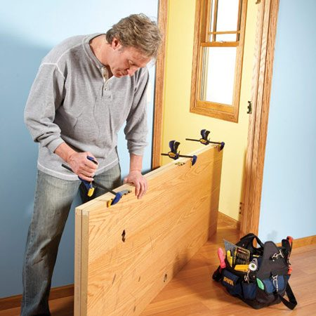 <b>Photo 1: You already have the perfect template</b></br> Carefully align the top and hinge edges of both doors and clamp them together.