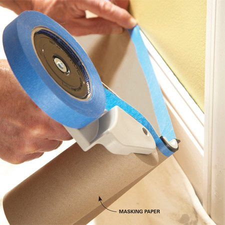 <b>Masking tool in action</b></br> Mask off baseboards quickly with a hand-masking tool. It applies the tape to the paper and cuts it to the right length with a twist of your wrist.