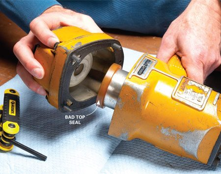 <b>Photo 1: Work from the top down</b></br> Remove the four hex screws and then the cap. Then remove the entire cylinder and driver assembly.