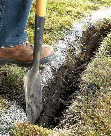 <b>Cut out the edge</b></br> Slice and then dig around the edge of the garden bed to make it easier to follow the shape as you remove or kill the grass.