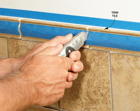<b>Apply tape to trim tiles</b></br> Photo 2: Tape off edges and trim tiles