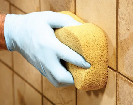 <b>Photo 8: Tool the lines</b></br> Depress the sponge with your index finger and smooth out high or uneven grout lines. Don't push too hard. Your goal is grout joints all the same shape and depth.