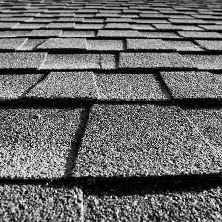 <b>Shingles</b><br/>Opinion is mixed about color affecting shingle longevity, but unanimous about the importance of good ventilation under the shingles.<br/>Christoph Riddle | Dreamstime.com