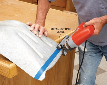 <b>Trim the tip</b></br> Cut the tip straight and square with a jigsaw. Then smooth the edge with a file or belt sander.