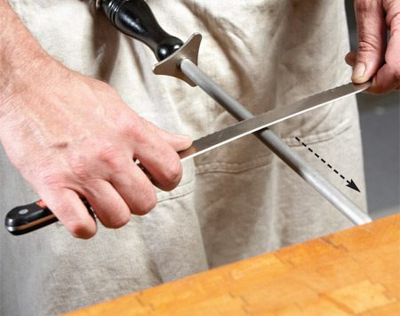 <b>Photo 1: Match the bevel to the pushing angle</b></br> Sharpen each scallop with the steel. Match the angle of the scallop and push the knife away from you. Do each scallop two or three times, then move on to the next.