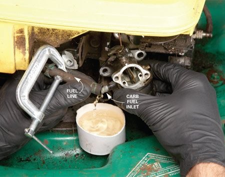 <b>Photo 1: Test for gas at the carb</b></br> Clamp off the fuel line. Then compress the spring clamp and slide it backward on the fuel line. Pull the tubing off the carburetor nipple and catch the gas in a small bowl.